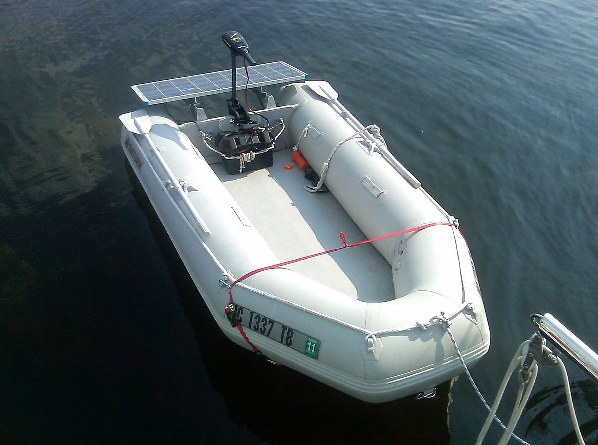 Saturn inflatable boat with solar charger and electrinc motor setup. Click to zoom in.